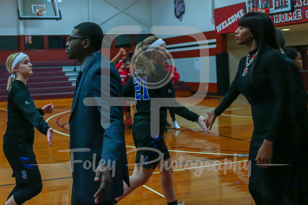 Becker College Hawks guard Allie Ablondi (4) Becker College Hawks head coach David Bostick