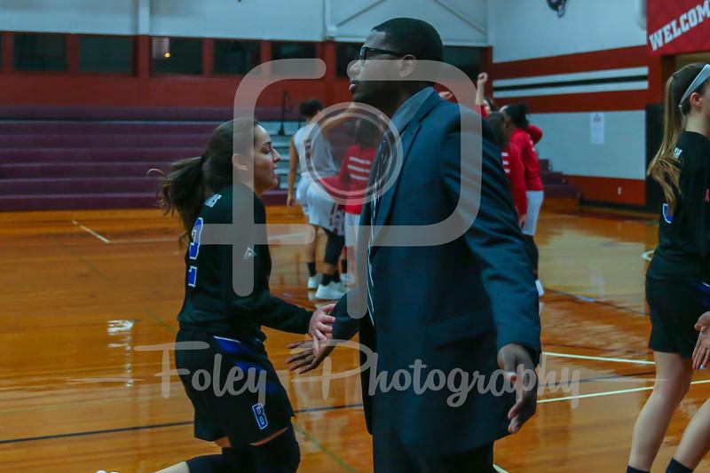 Becker College Hawks guard Jazlyn Contreras (12) Becker College Hawks head coach David Bostick