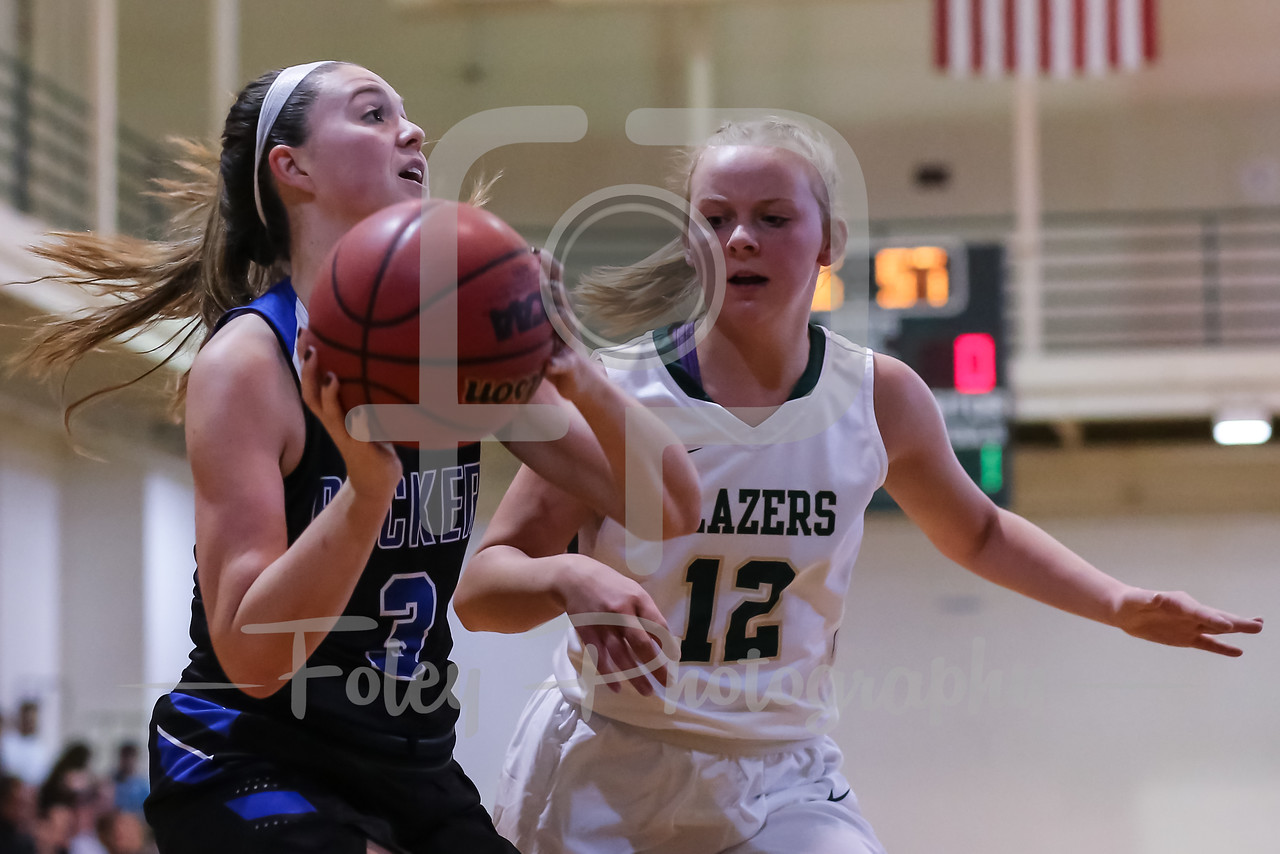 Becker College Hawks guard Cassidy Harrison (3) Elms College Blazers Molly Moulton (12)