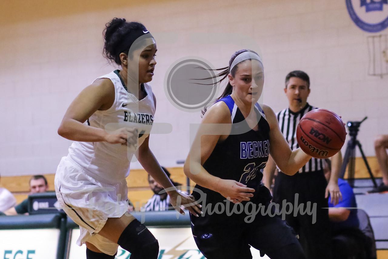 Becker College Hawks forward Ciara McKissick (24) Elms College Blazers Kayla Soto (21)