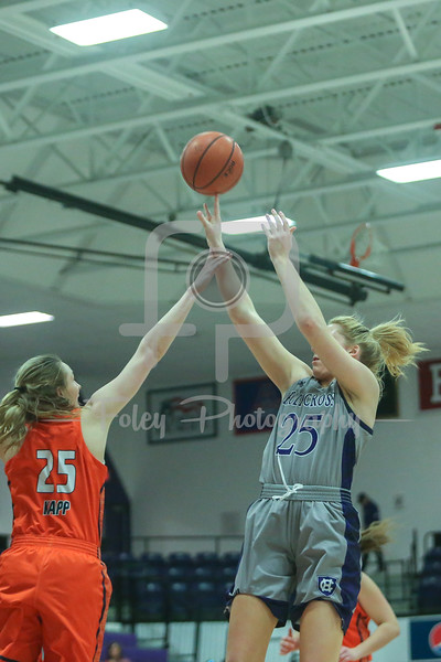 Holy Cross Crusaders forward Lauren Manis (25) Bucknell Bison guard Abby Kapp (25)