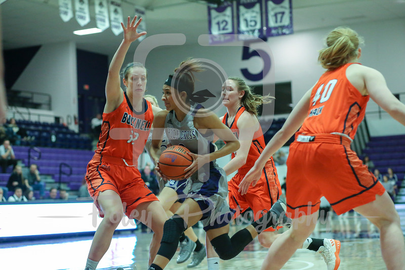 Holy Cross Crusaders guard Infiniti Thomas-Waheed (3) Bucknell Bison forward Catherine Romaine (32)