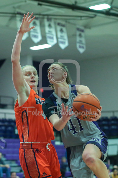 Holy Cross Crusaders forward Amy Hasenauer (41) Bucknell Bison guard Ellie Mack (40)