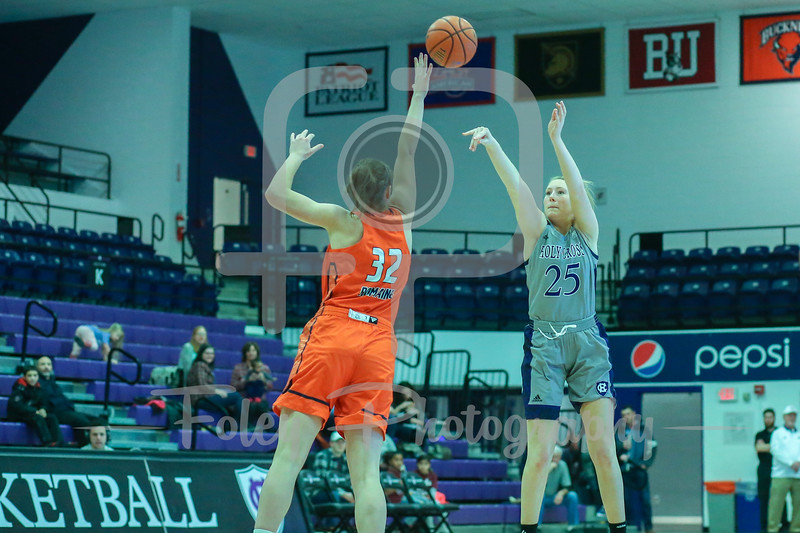 Holy Cross Crusaders forward Lauren Manis (25) Bucknell Bison forward Catherine Romaine (32)