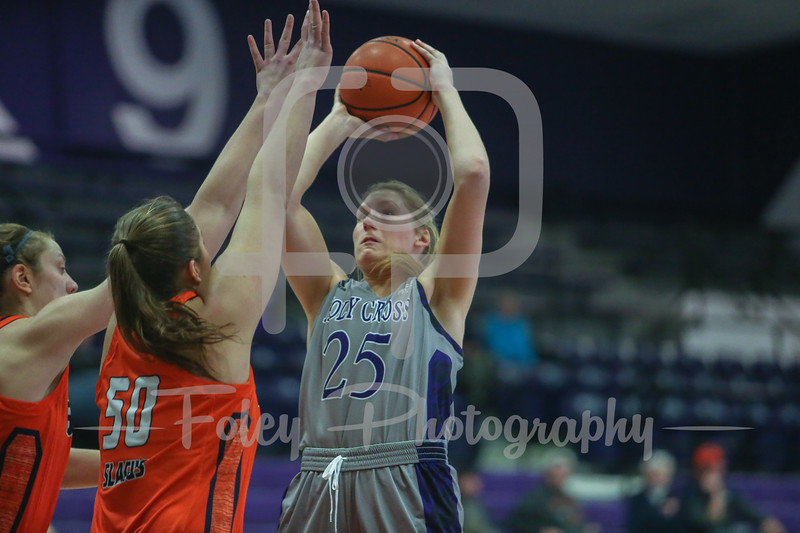 Holy Cross Crusaders forward Lauren Manis (25) Bucknell Bison forward Kaitlyn Slagus (50)