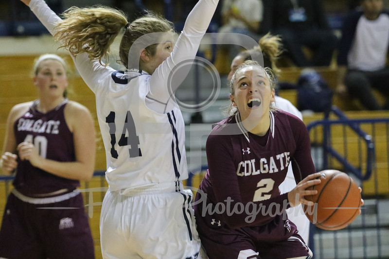 Colgate Raiders guard Tegan Graham (2) Yale Bulldogs guard Mary Ann Santucci (14)