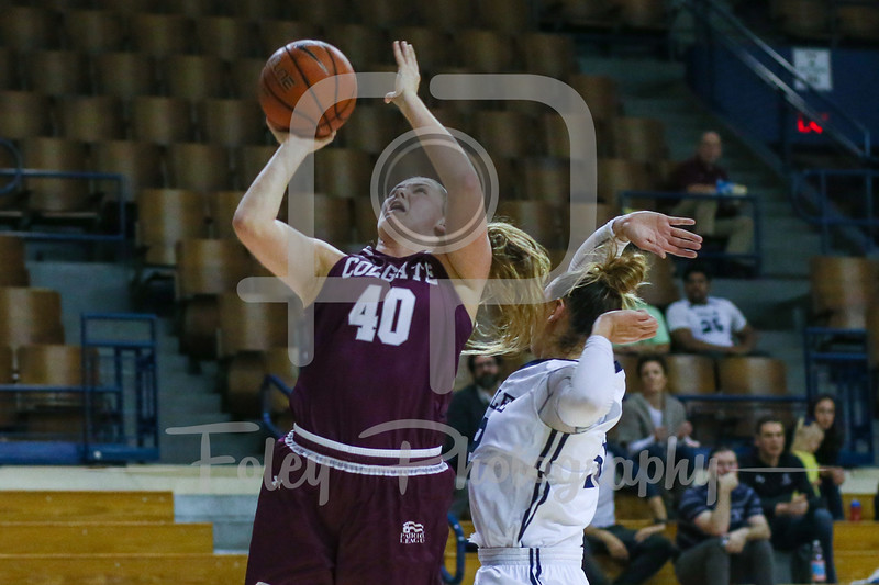 Colgate Raiders forward Summer King (40) Yale Bulldogs forward Jen Berkowitz (12)