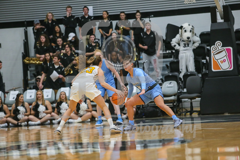 Columbia Lions guard Paige Tippet (4) Providence Lady Friars guard Clara Che (23)