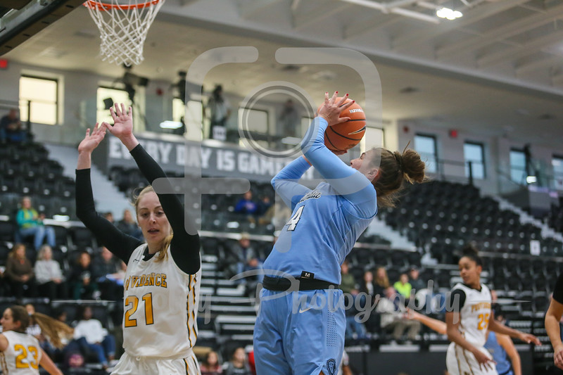 Columbia Lions guard Paige Tippet (4) Providence Lady Friars guard Maddie Jolin (21)