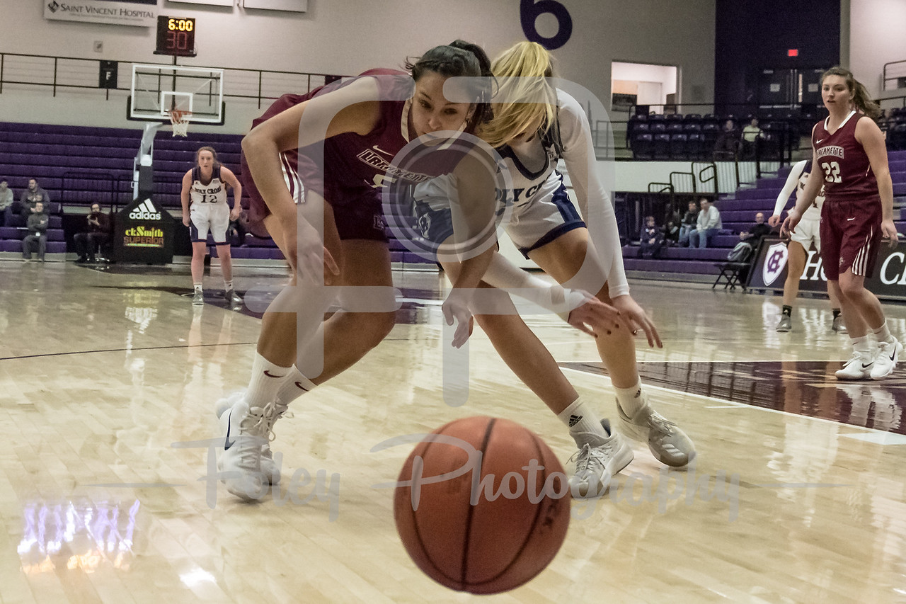 Holy Cross Crusaders forward Lauren Manis (25) Lafayette Leopards guard Anna Ptasinski (5)