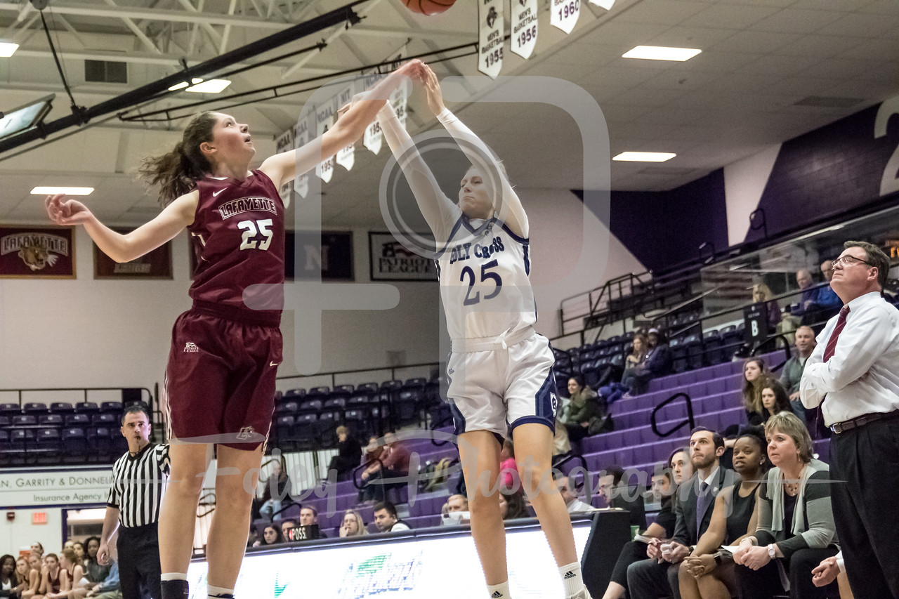 Holy Cross Crusaders forward Lauren Manis (25) Lafayette Leopards forward Natalie Kucowski (25)