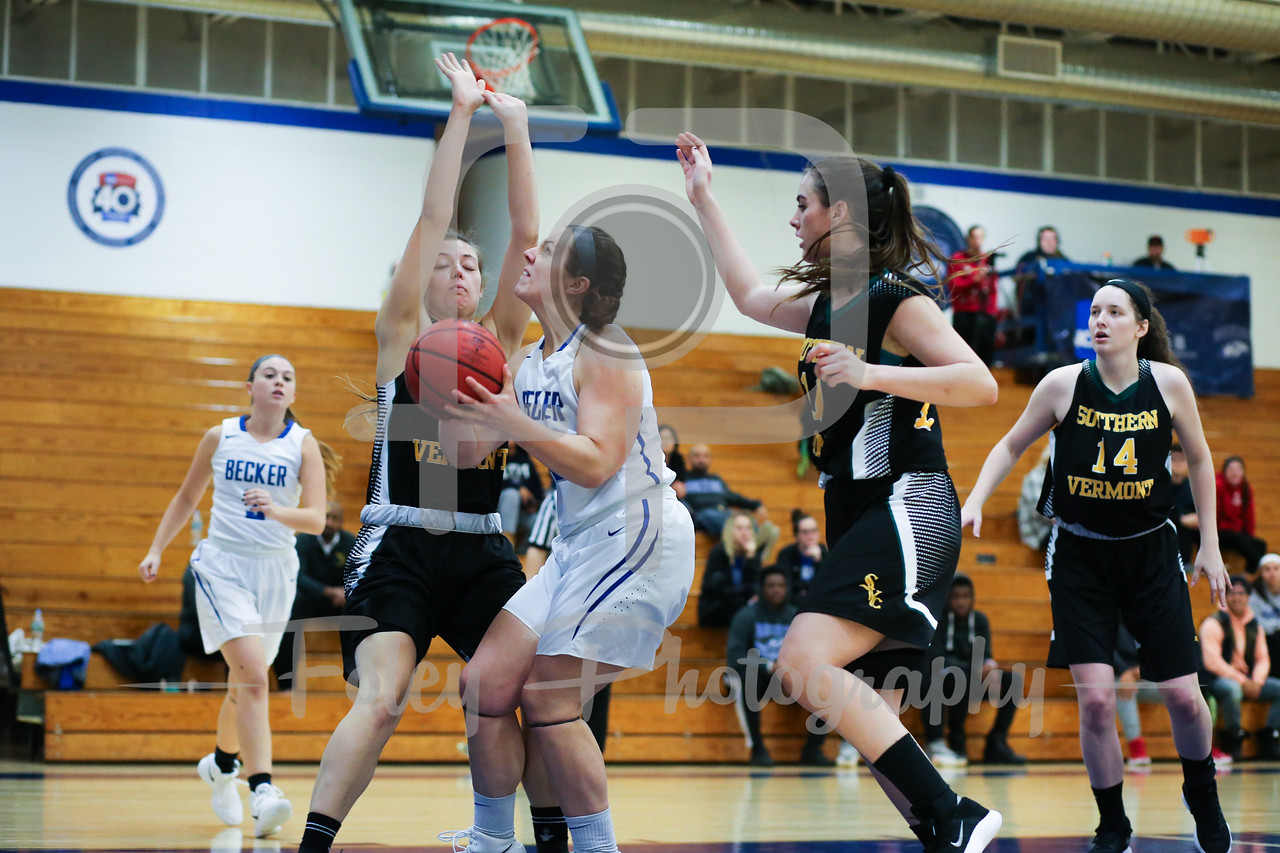 Becker College Hawks forward Sarah Ware (42) Southern Vermont Mountaineers Maddy Main (2)