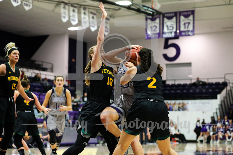 Vermont Catamounts forward Hanna Crymble (10) Holy Cross Crusaders forward Lauren Manis (25)