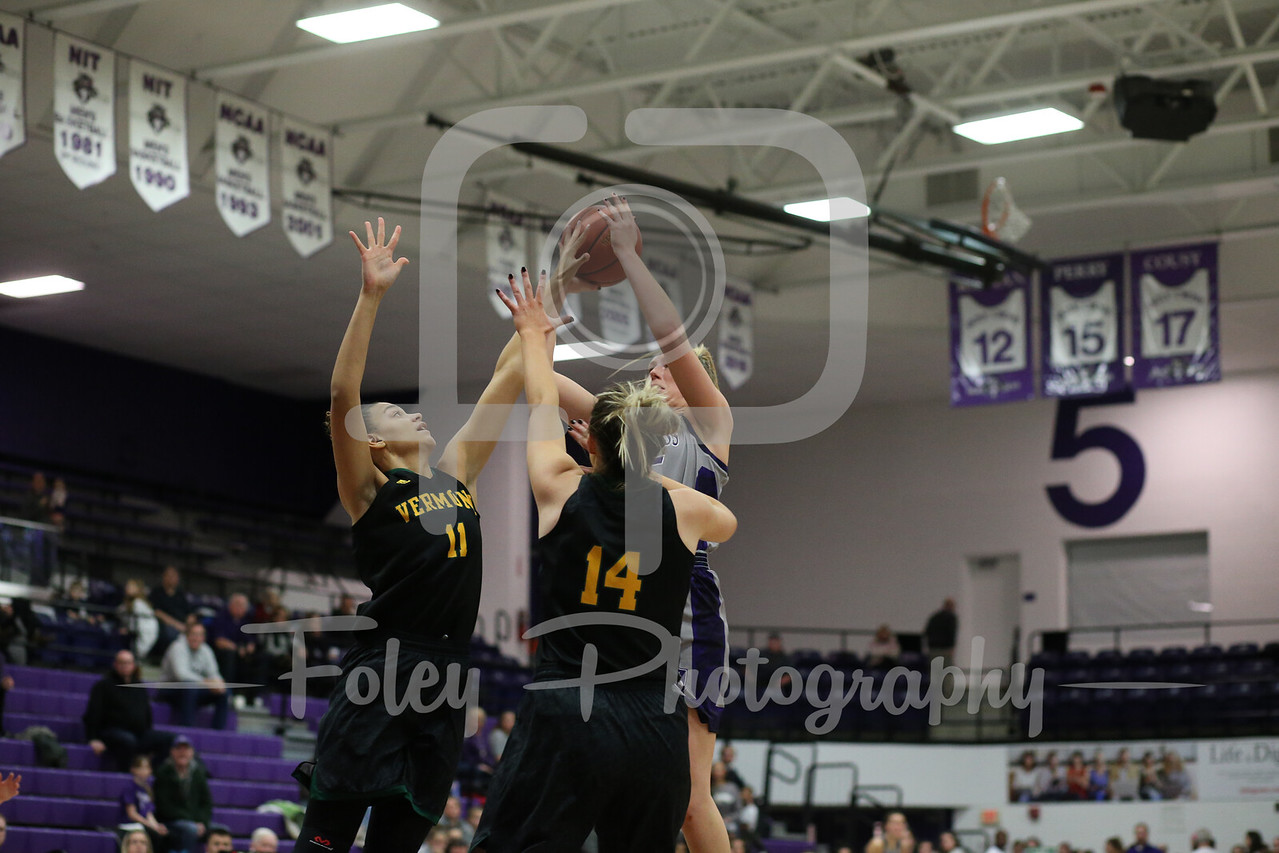 Holy Cross Crusaders forward Lauren Manis (25) Vermont Catamounts forward Candice Wright (11) Vermont Catamounts forward Lauren Handy (14)