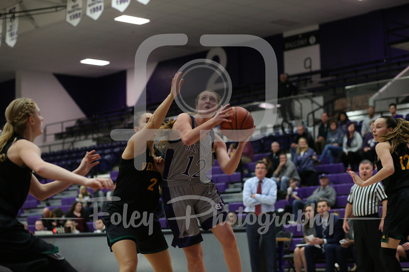 Holy Cross Crusaders guard Madalyn Smith (12) Vermont Catamounts guard Josie Larkins (2)