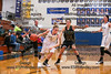 Findlay's Samantha Shardo (12) drives to the basket past Clay's Karleigh Clere (12).