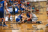 Findlay's Allison Taylor (33) hits the hardcourt as she wrestles with Defiance's Natalie Wichman (32, left) and MaKaya Allen (4, middle) for possession of a loose ball.