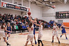 Elmwood's Jill Hannah (14) is fouled as she drives to the basket between VB's Mackenzie Saltzman (12) and Breanna Tabler (3). Saltzman was called for the foul.