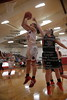 Arlington's Hannah Willow (10) gets behind NB's Hailey Watson (24) and lays in a bucket.