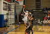 LB's Jensen Hiegel (21) finishes a fastbreak with a layup ahead of St. Wendelin's Peighton Troike and Emma Prince (10).