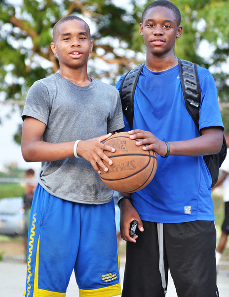Tomorrow's Stars?  Khalil Gillian (left) and friend, before a Chosen League game.  Khalil is in 7th grade and already is on the Chosen League champion Team Wayne Ellington.  He doesn't see much playinng time yet, but then, the other guys on the team are 3-5 grades ahead of him so.......