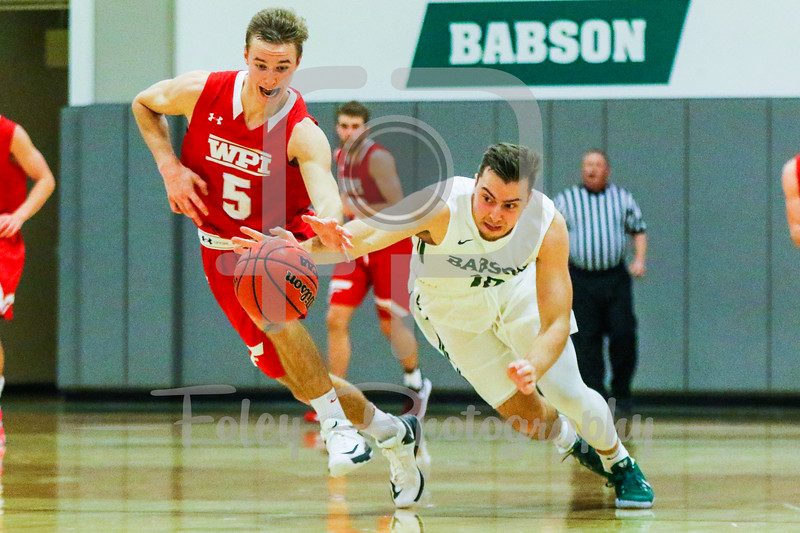 WPI Engineers guard Chris Rodgers (5) Babson College Beavers forward David Stauffer (12)