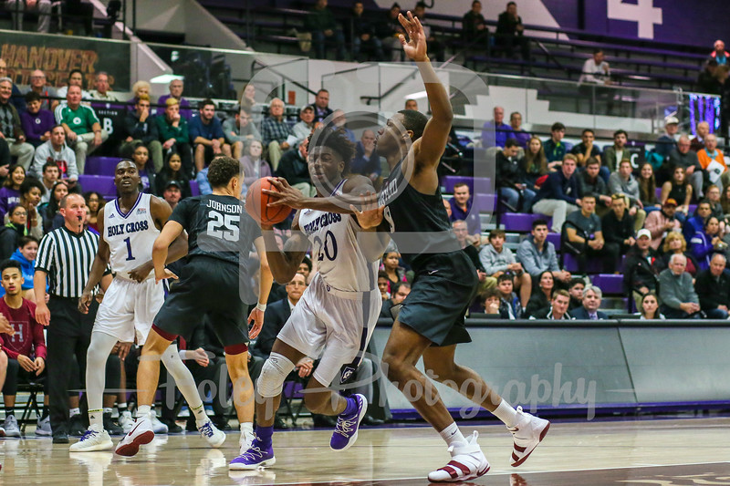 Nov. 16, 2017, Hart Center, Worcester, Massachusetts: during the Crusaders 73-69 victory over the Crimson in a non-conference matchup.