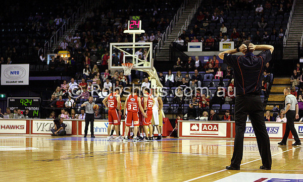 Cairns coach Aaron Fearne appears to attempt to tear his hair out after a refereeing decision goes against his team - Images from the 2009/10 NBL Round 3 match between the Wollongong Hawks and Cairns Taipans played at Win Entertainment Centre on Saturday the 10th of October 2009. The match was won by Wollongong 71-59. (PHOTO: ROB SHEELEY - SMP IMAGES) These images are intended for editorial use only (e.g. news or commentary print or electronic). Any commercial or promotional use requires additional clearance.