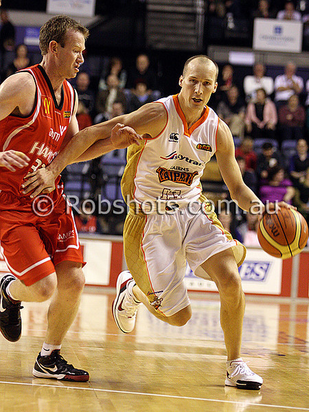 Phill Jones - Cairns gets past Wollongong's Matt Campbell - Images from the 2009/10 NBL Round 3 match between the Wollongong Hawks and Cairns Taipans played at Win Entertainment Centre on Saturday the 10th of October 2009. The match was won by Wollongong 71-59. (PHOTO: ROB SHEELEY - SMP IMAGES) These images are intended for editorial use only (e.g. news or commentary print or electronic). Any commercial or promotional use requires additional clearance.