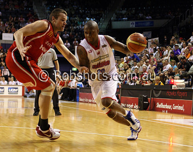 John Gilchrist - Adelaide 36er's  drives past Wollongong's Larry Davidson - Images from the 2009/10 NBL Round 10 match between the Wollongong Hawks and Adelaide 36er's played at Win Entertainment Centre on Wednesday the 25th of November 2009. The match was won by Adelaide 82-59 . (PHOTO: ROB SHEELEY - SMP IMAGES) These images are intended for editorial use only (e.g. news or commentary print or electronic). Any commercial or promotional use requires additional clearance.