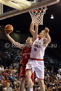 Cam Tragardh - Wollongong Hawks attempts to score a basket despite heavy defence from Adelaide's Adam Ballinger - Images from the 2009/10 NBL Round 10 match between the Wollongong Hawks and Adelaide 36er's played at Win Entertainment Centre on Wednesday the 25th of November 2009. The match was won by Adelaide 82-59 . (PHOTO: ROB SHEELEY - SMP IMAGES) These images are intended for editorial use only (e.g. news or commentary print or electronic). Any commercial or promotional use requires additional clearance.