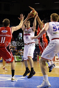 Brad Hill - Adelaide 36er's looks to pass in heavy traffic  - Images from the 2009/10 NBL Round 10 match between the Wollongong Hawks and Adelaide 36er's played at Win Entertainment Centre on Wednesday the 25th of November 2009. The match was won by Adelaide 82-59 . (PHOTO: ROB SHEELEY - SMP IMAGES) These images are intended for editorial use only (e.g. news or commentary print or electronic). Any commercial or promotional use requires additional clearance.