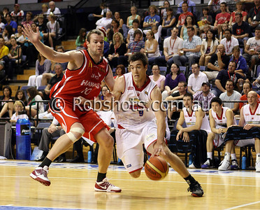 Brad Hill - Adelaide 36er's drives past Wollongong centre Larry Davidson - Images from the 2009/10 NBL Round 10 match between the Wollongong Hawks and Adelaide 36er's played at Win Entertainment Centre on Wednesday the 25th of November 2009. The match was won by Adelaide 82-59 . (PHOTO: ROB SHEELEY - SMP IMAGES) These images are intended for editorial use only (e.g. news or commentary print or electronic). Any commercial or promotional use requires additional clearance.