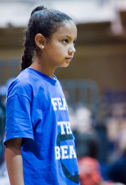 It was the cheerleaders who earned this girl's rapt attention