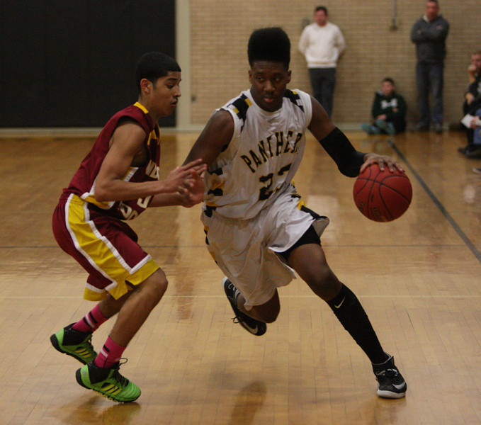 Christopher DeSousa drives past Alphonso Zaporta in the first half.