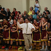 Windsor Locks coach Mike Mascaro signals his team from the sideline.