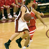 Mesa Red Mountain High School basketball team in action against Centennial