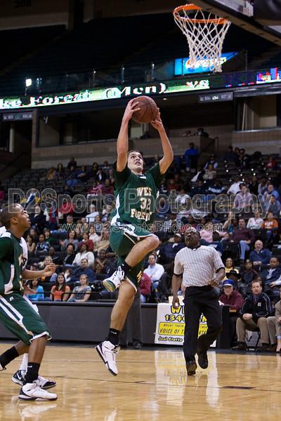 Reagan Raiders vs W Forsyth Titans, Men's High School Varsity Basketball<br /> Monday, December 28, 2009 at LJVM Coliseum<br /> Winston-Salem, North Carolina<br /> (file 192238_803Q5204_1D3)