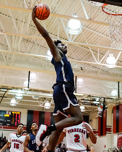 Lorain #2 Taevon Pierre-Louis gets ready to deliver the dunk against Elyria Friday December 28.  photo Joe Colon