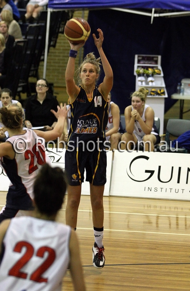 Mikaela Dombkins - Sydney Uni Flames - Images from the 2009/10 WNBL Round 9 match between the Sydney Uni Flames and the Australian Institute Of Sport at the Acuvue Sports Hall, Sydney on Wednesday the 2nd of December 2009. The match was won by Sydney Uni 101-49.   (PHOTO: ROB SHEELEY - SMP IMAGES) These images are intended for editorial use only (e.g. news or commentary print or electronic). Any commercial or promotional use requires additional clearance.