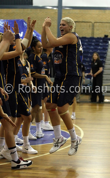 Ellie Manou - Sydney Uni Flames high fives team mates as she takes the court - Images from the 2009/10 WNBL Round 9 match between the Sydney Uni Flames and the Australian Institute Of Sport at the Acuvue Sports Hall, Sydney on Wednesday the 2nd of December 2009. The match was won by Sydney Uni 101-49.   (PHOTO: ROB SHEELEY - SMP IMAGES) These images are intended for editorial use only (e.g. news or commentary print or electronic). Any commercial or promotional use requires additional clearance.