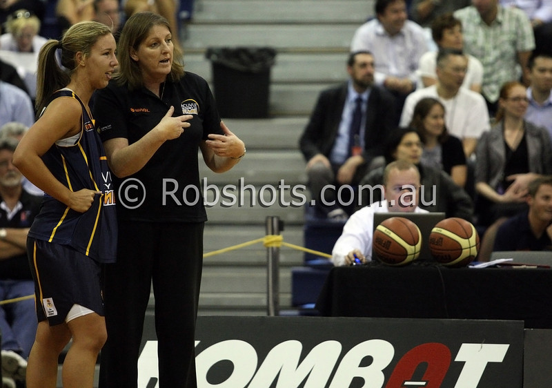 Coach Karen Dalton talks tactics with Jaimee Kennedy of the Sydney Uni Flames - Images from the 2009/10 WNBL Round 9 match between the Sydney Uni Flames and the Australian Institute Of Sport at the Acuvue Sports Hall, Sydney on Wednesday the 2nd of December 2009. The match was won by Sydney Uni 101-49.   (PHOTO: ROB SHEELEY - SMP IMAGES) These images are intended for editorial use only (e.g. news or commentary print or electronic). Any commercial or promotional use requires additional clearance.
