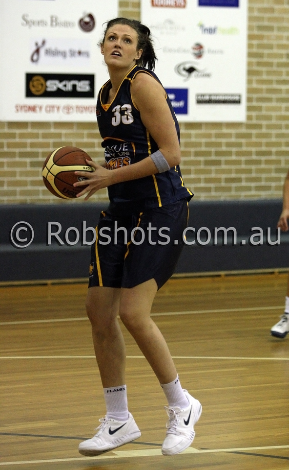 Rachel Herrick - Sydney Uni Flames - Images from the 2009/10 WNBL Round 9 match between the Sydney Uni Flames and the Australian Institute Of Sport at the Acuvue Sports Hall, Sydney on Wednesday the 2nd of December 2009. The match was won by Sydney Uni 101-49.   (PHOTO: ROB SHEELEY - SMP IMAGES) These images are intended for editorial use only (e.g. news or commentary print or electronic). Any commercial or promotional use requires additional clearance.