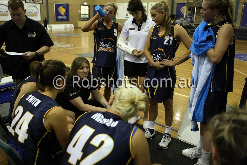 Sydney Uni coach Karen Dalton talks to her team during a time out - Images from the 2009/10 WNBL Round 9 match between the Sydney Uni Flames and the Australian Institute Of Sport at the Acuvue Sports Hall, Sydney on Wednesday the 2nd of December 2009. The match was won by Sydney Uni 101-49.   (PHOTO: ROB SHEELEY - SMP IMAGES) These images are intended for editorial use only (e.g. news or commentary print or electronic). Any commercial or promotional use requires additional clearance.