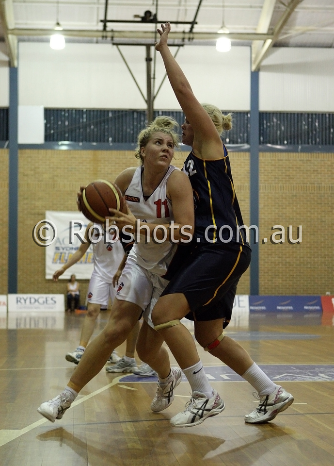 Nadeen Payne - A.I.S - Images from the 2009/10 WNBL Round 9 match between the Sydney Uni Flames and the Australian Institute Of Sport at the Acuvue Sports Hall, Sydney on Wednesday the 2nd of December 2009. The match was won by Sydney Uni 101-49.   (PHOTO: ROB SHEELEY - SMP IMAGES) These images are intended for editorial use only (e.g. news or commentary print or electronic). Any commercial or promotional use requires additional clearance.
