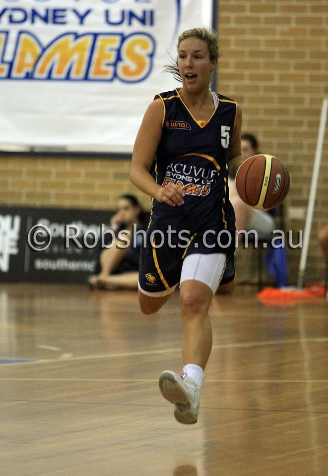Jaimee Kennedy - Sydney Uni Flames - Images from the 2009/10 WNBL Round 9 match between the Sydney Uni Flames and the Australian Institute Of Sport at the Acuvue Sports Hall, Sydney on Wednesday the 2nd of December 2009. The match was won by Sydney Uni 101-49.   (PHOTO: ROB SHEELEY - SMP IMAGES) These images are intended for editorial use only (e.g. news or commentary print or electronic). Any commercial or promotional use requires additional clearance.