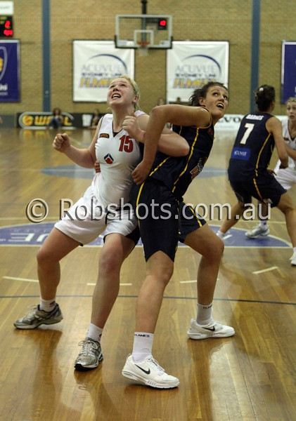 Tayla Roberts - A.I.S and Rachel Herrick - Sydney Uni Flames contest a rebound - Images from the 2009/10 WNBL Round 9 match between the Sydney Uni Flames and the Australian Institute Of Sport at the Acuvue Sports Hall, Sydney on Wednesday the 2nd of December 2009. The match was won by Sydney Uni 101-49.   (PHOTO: ROB SHEELEY - SMP IMAGES) These images are intended for editorial use only (e.g. news or commentary print or electronic). Any commercial or promotional use requires additional clearance.