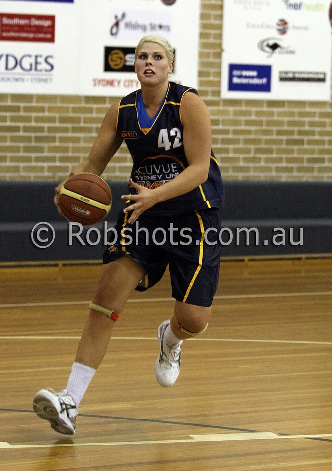 Ellie Manou - Sydney Uni Flames drives to the basket - Images from the 2009/10 WNBL Round 9 match between the Sydney Uni Flames and the Australian Institute Of Sport at the Acuvue Sports Hall, Sydney on Wednesday the 2nd of December 2009. The match was won by Sydney Uni 101-49.   (PHOTO: ROB SHEELEY - SMP IMAGES) These images are intended for editorial use only (e.g. news or commentary print or electronic). Any commercial or promotional use requires additional clearance.