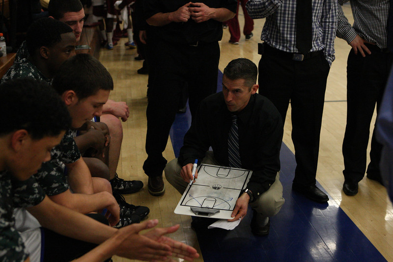 Coach Luke Reilly of East Catholic outlines a plan at the start of the game.