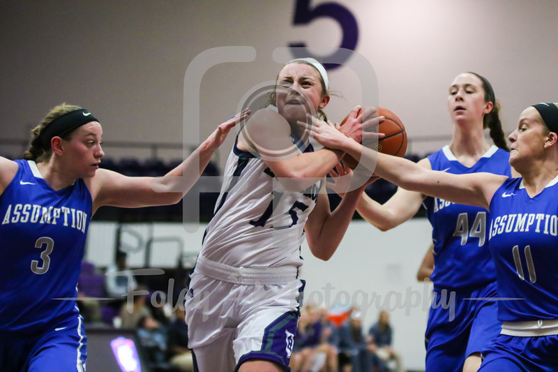 Holy Cross Crusaders Madelyn Ganser (15) Assumption College guard Kelly Carey (11)